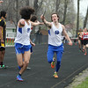 Michael Johnson - The News-Herald<br /> Gilmour's John Sullivan (right) passes the baton to Zack Asher (left) in the Men's 4x800 Meter Relay during the Ranger Relays at North High School on April 23, 2016.