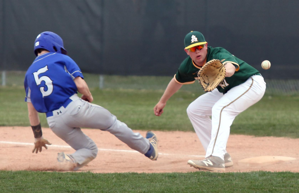 . Randy Meyers - The Morning Journal Amherst first baseman Jacob Lezon  makes the catch on a throw down  as Midview\'s Cam Honis slides back  safely