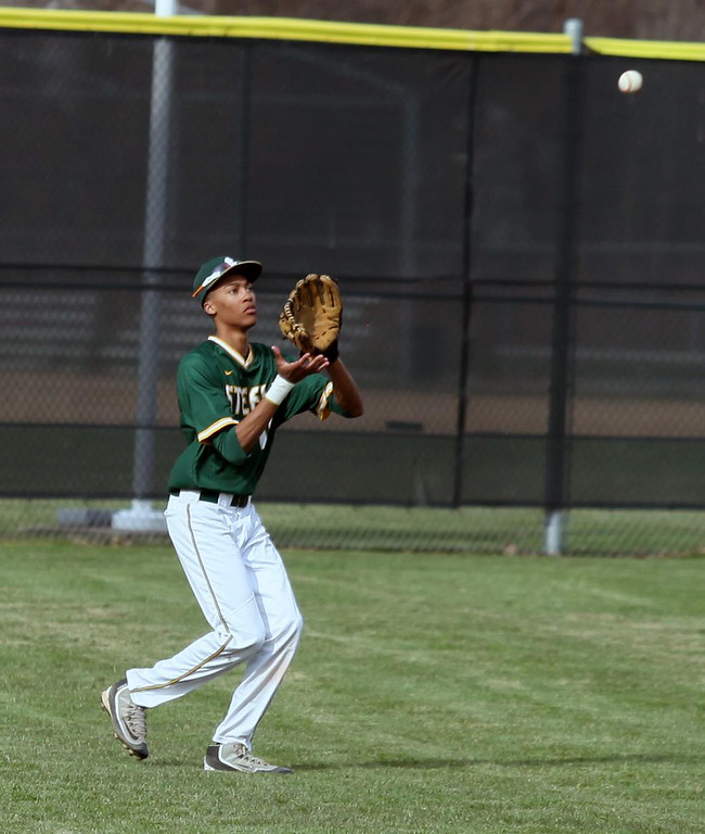 . Randy Meyers - The Morning Journal Left fielder TJ Staton of Amherst  looks in a fly ball for the out against Midview on Monday
