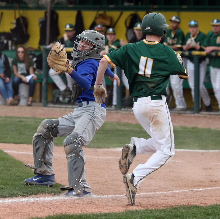 . Randy Meyers - The Morning Journal Jake Hart of Amherst runs by  Midview catcher Tyler Cooper to score on Monday