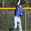 Randy Meyers - The Morning Journal<br /> Open Door outfielder Carter Wright just misses a fly ball to deep center against Lake Ridge Acadamy on April 24.