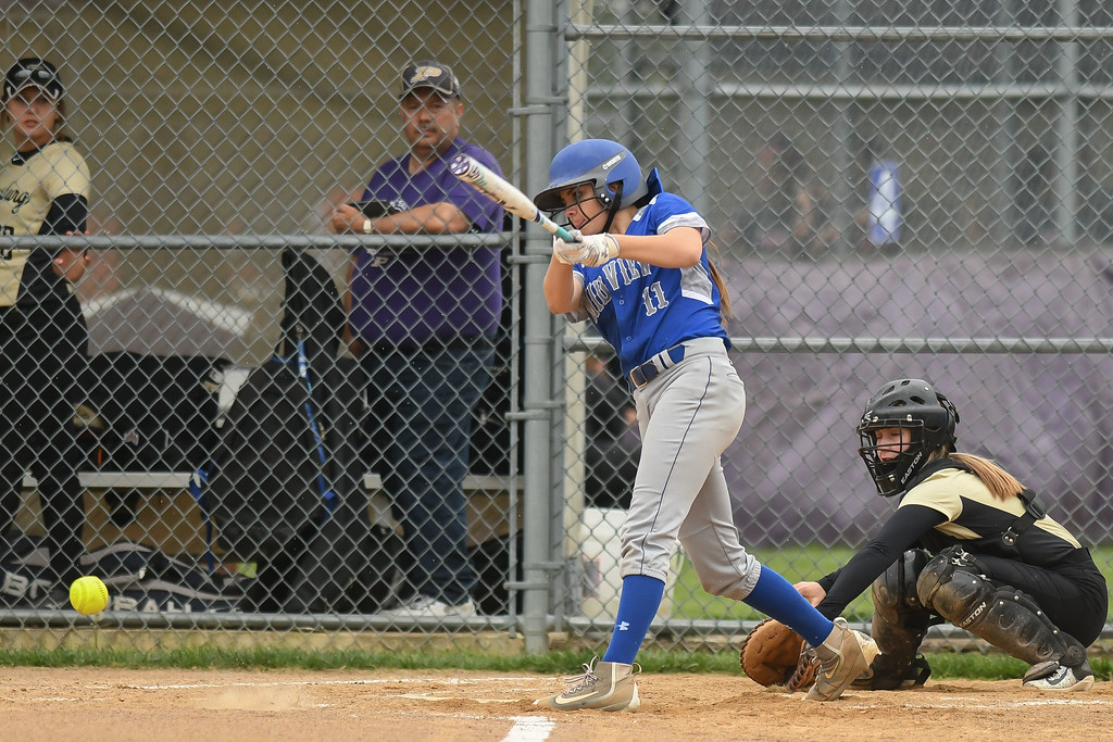 . Eric Bonzar�The Morning Journal Midview freshman Marcella McMahon connects on a pitch, April 28, 2017.