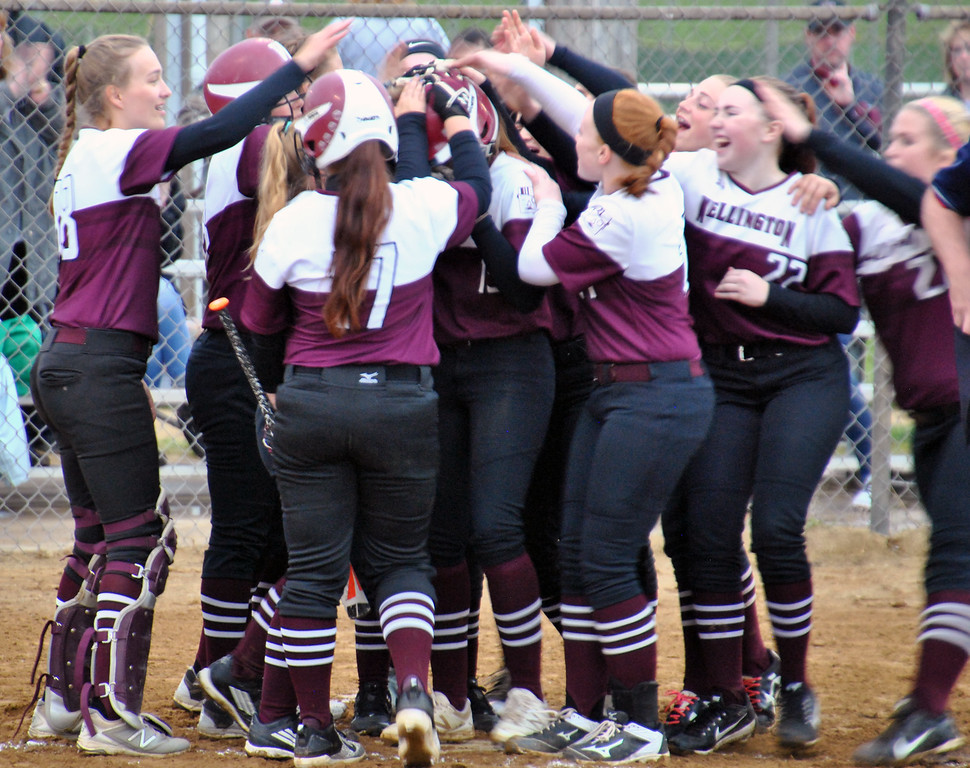 . Jon Behm - The Morning Journal Teammates mob Wellington\'s Brooklinn Damiano, center, after her home run during the bottom of the first inning against Girard on April 28 at Wellington Community Park.