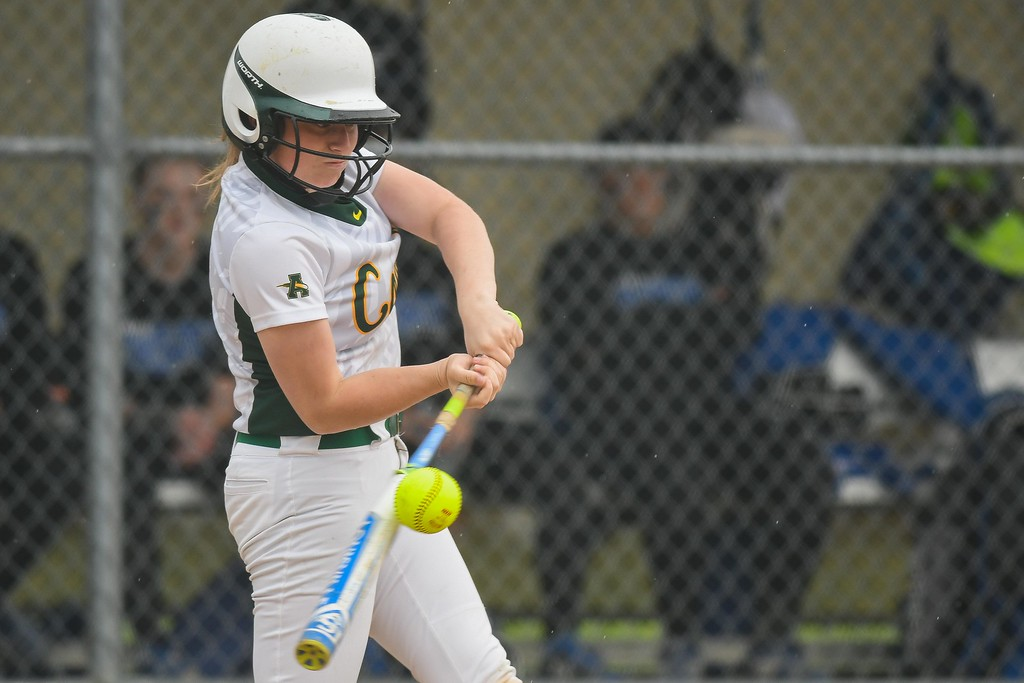 . Eric Bonzar�The Morning Journal Amherst\'s Amanda Crisler connects on a pitch, April 28, 2017.