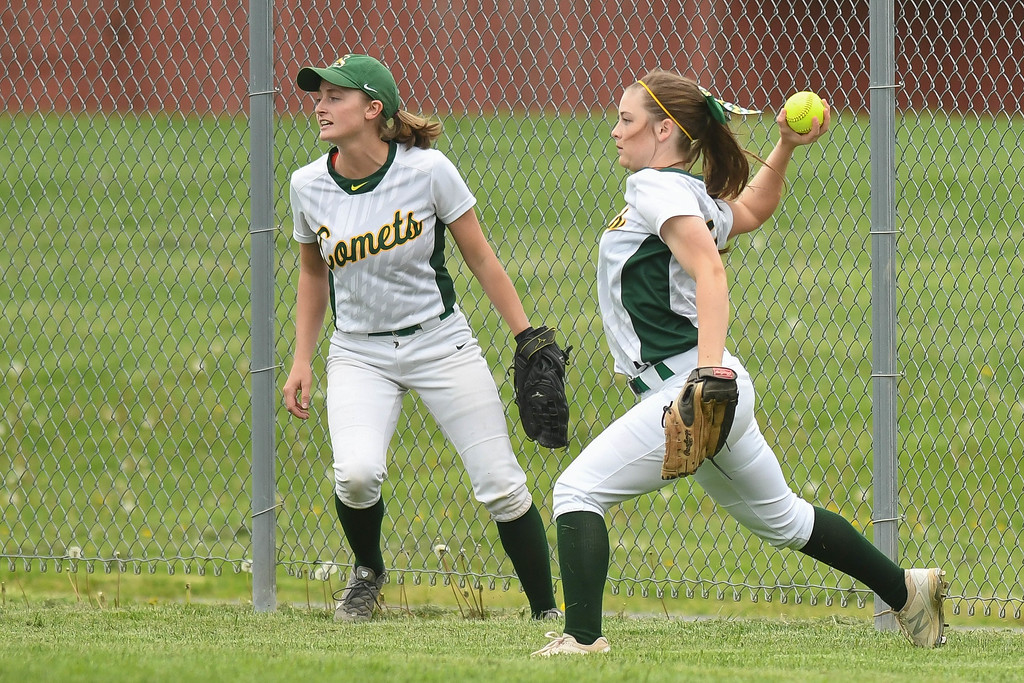 . Eric Bonzar�The Morning Journal Amherst\'s Amanda Crisler, right, fields a fly ball to to the fence, April 28, 2017.