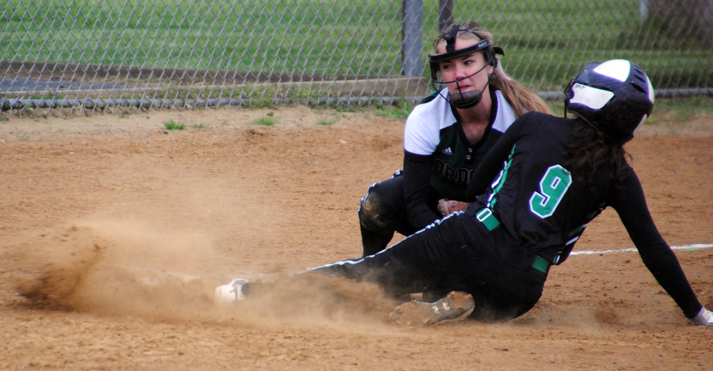 . Jon Behm - The Morning Journal Nordonia\'s Rachel Vickers tags out Columbia\'s Natalie Wilkins (9) during the bottom of the third inning on April 28 at Wellington Community Park.