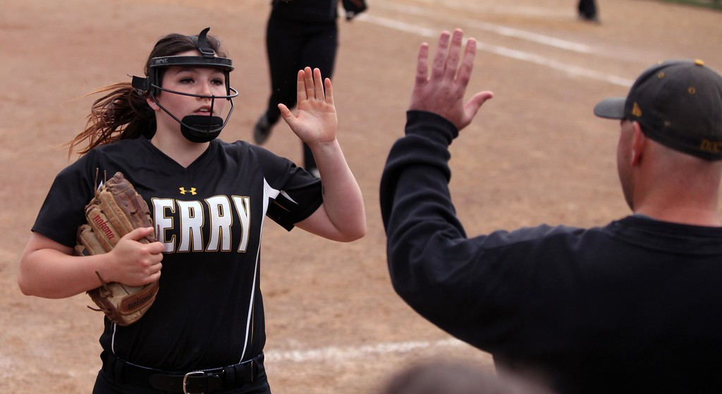 . Randy Meyers - The Morning Journal Perry starting pitcher Makenna Durieux gets a high five from coach Scott Daugherty after getting out of an inning.