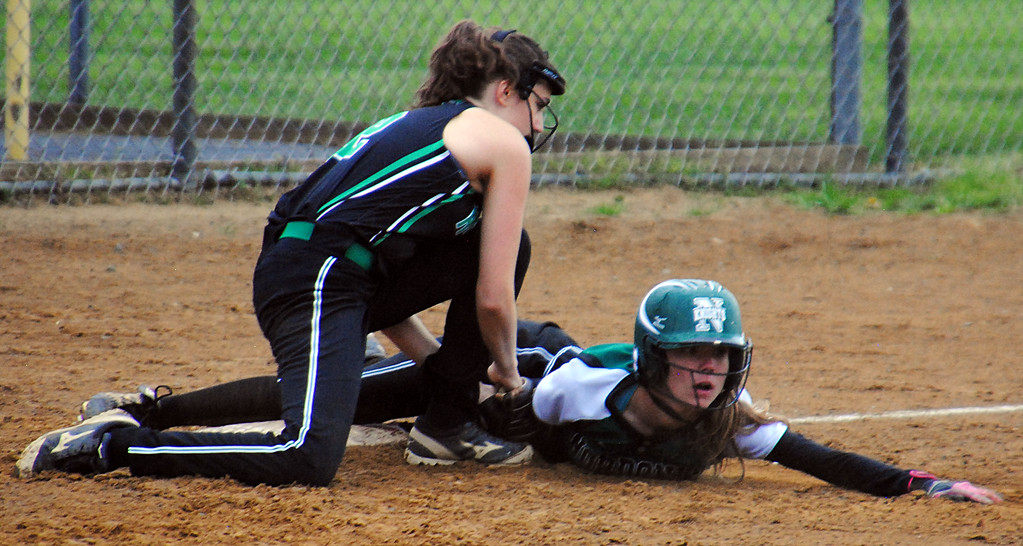 . Jon Behm - The Morning Journal Nordonia\'s Rachel Vickers, right, and Columbia\'s Emily Berg look to the umpire for a call during the top of the fifth inning on April 28 at Wellington Community Park. Vickers was out on the play.