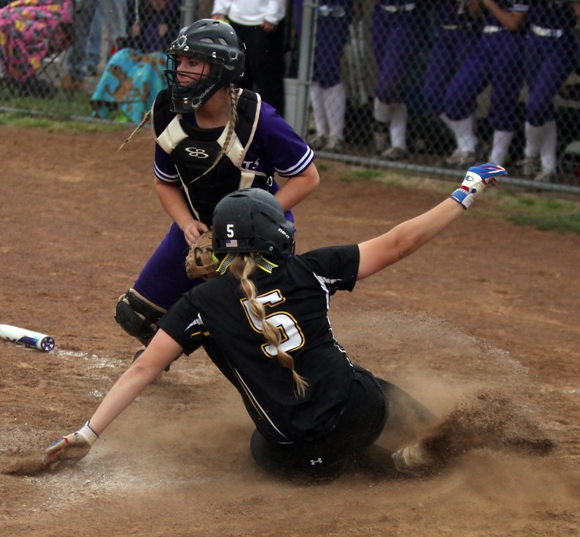 . Randy Meyers - The Morning Journal Perry\'s Nikki Saibene slides into home safely and scores before the tag by Keystone catcher Summer Metcalf on April 28.