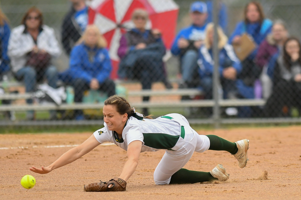 . Eric Bonzar�The Morning Journal Amherst\'s Sarah Miller dives for a ground ball up the middle, April 28, 2017.