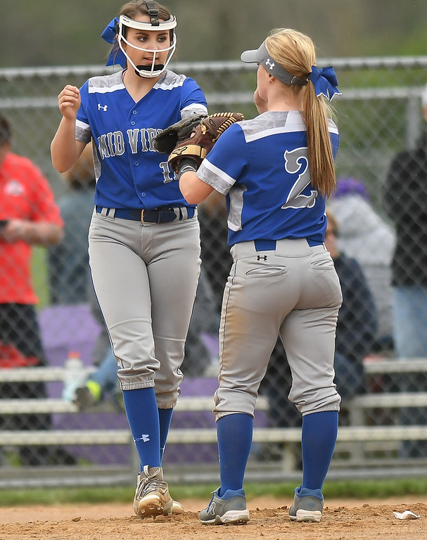. Eric Bonzar�The Morning Journal Midview pitcher Marcella McMahon and Ella Leonard (2) celebrate an out at the pitchers\' mound, April 28, 2017.