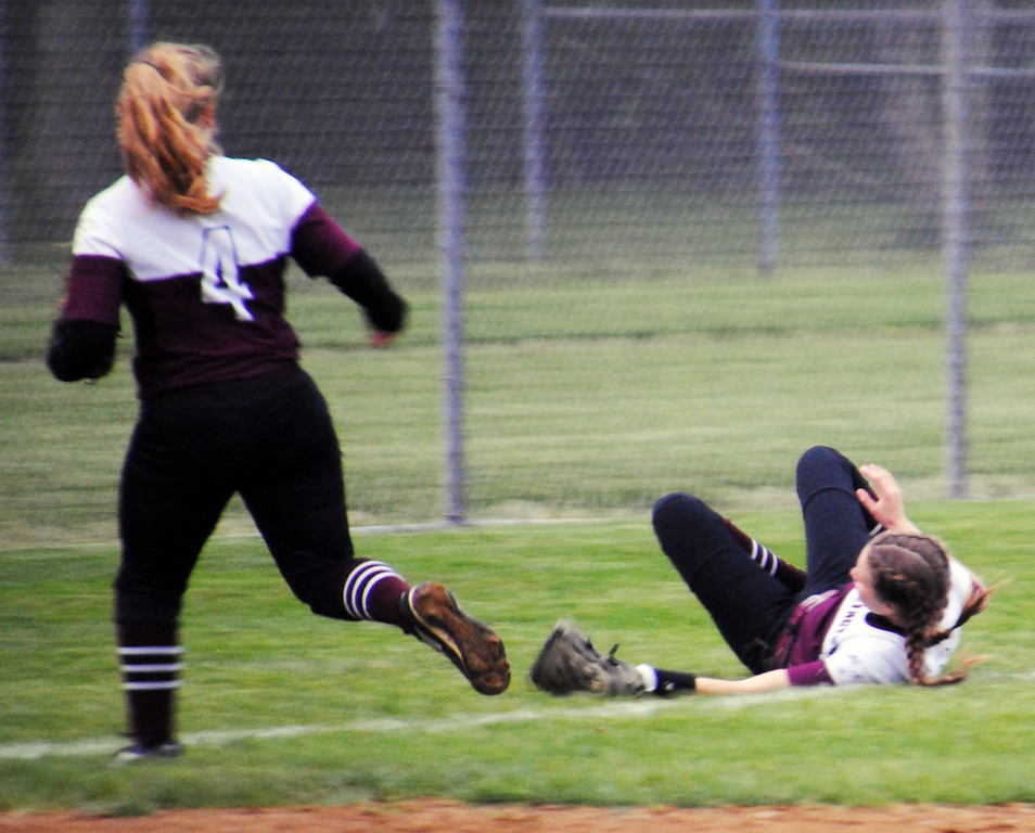 . Jon Behm - The Morning Journal Wellington\'s Lexi Wright makes a sliding catch as teammate Krista Denny watches during the top of the first inning against Girard on April 28 at Wellington Community Park.