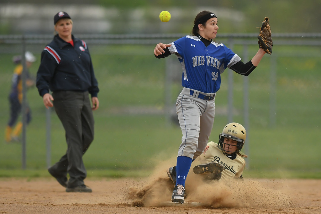. Eric Bonzar�The Morning Journal Midview\'s Hailey Ivan cannot hang on to the ball as Perrysburg\'s Caitlin Reighard slides into second base, April 28, 2017.