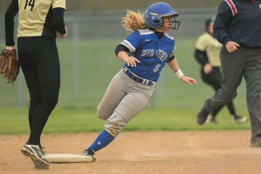 . Eric Bonzar�The Morning Journal Midview\'s Hannah Taulbee rounds second base, April 28, 2017.