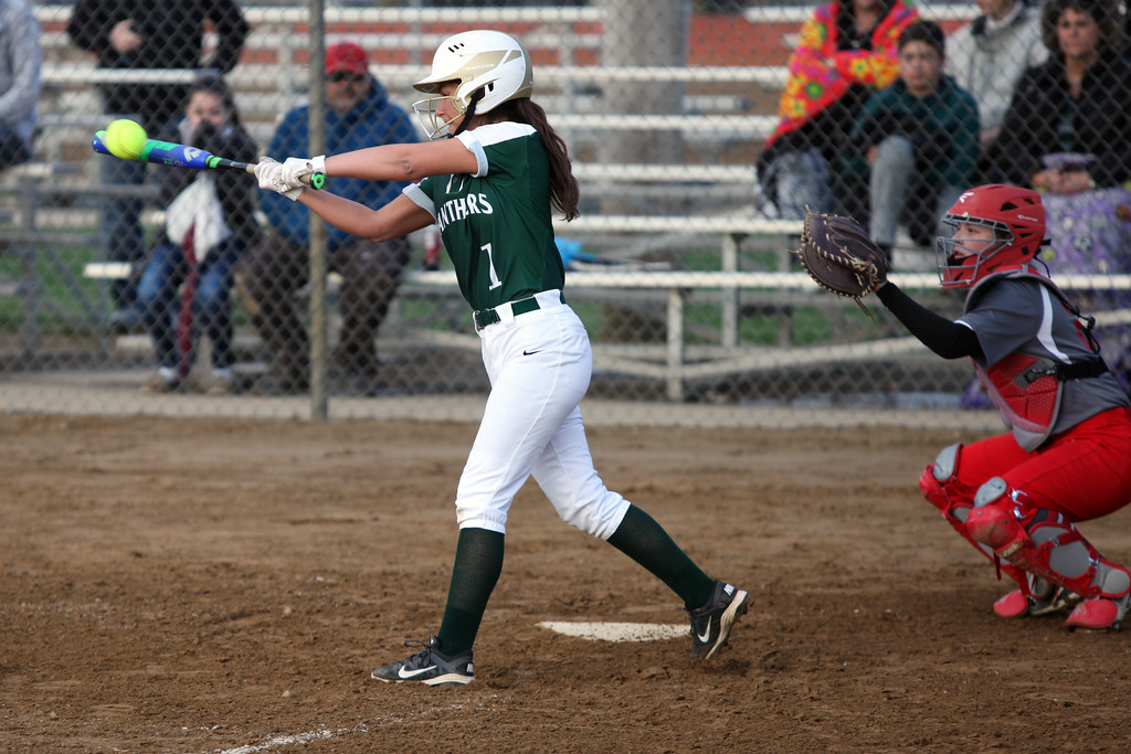. Randy Meyers - The Morning Journal<br> Ashley Cascio of Elyria Catholic lines a base hit against Fairview during the Prebis Memorial Classic at Wellington Community Park on April 27.