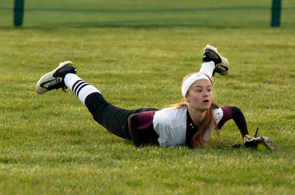 . Jen Forbus - The Morning Journal<br> Wellington left fielder Lexi Wright makes a diving catch in the final inning of the Dukes\' contest against the Olmsted Falls Bulldogs on April 27 during the Prebis Softball Classic at Wellington Community Park.