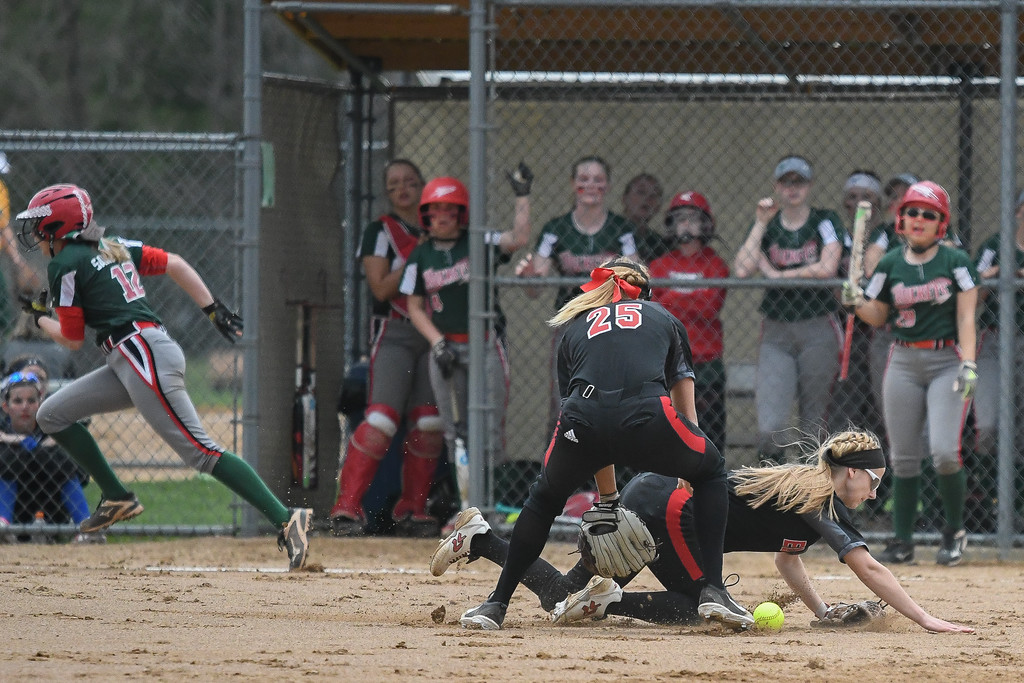 . Eric Bonzar�The Morning Journal<br> Elyria pitcher Isabella St. Peter and third baseman April Howser (25) collide near the mound as they try to field a blooper hit by Oak Harbor\'s Kaytlynn Sandwisch (12) at LaGrange Community Park during the Prebis Memorial Classic on April 27.