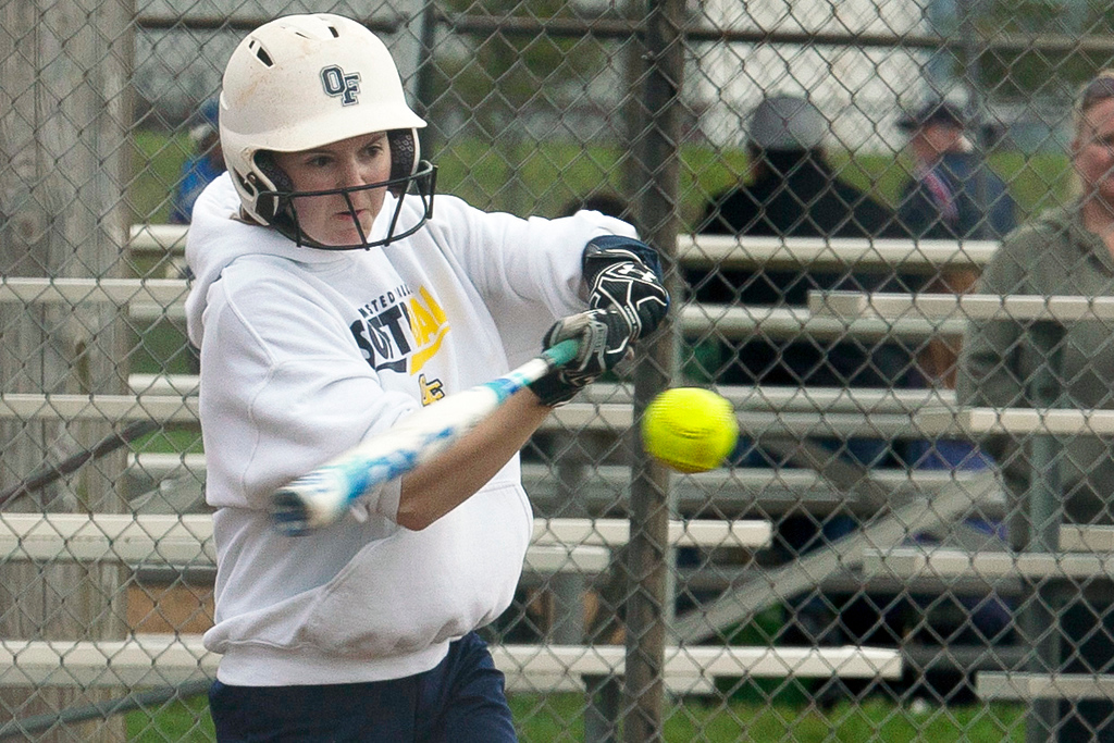 . Jen Forbus - The Morning Journal<br> Olmsted Falls pitcher Keeley Patton connects with a pitch during the Bulldogs\' game with the Wellington Dukes on April 27 during the Prebis Softball Classic at Wellington Community Park.