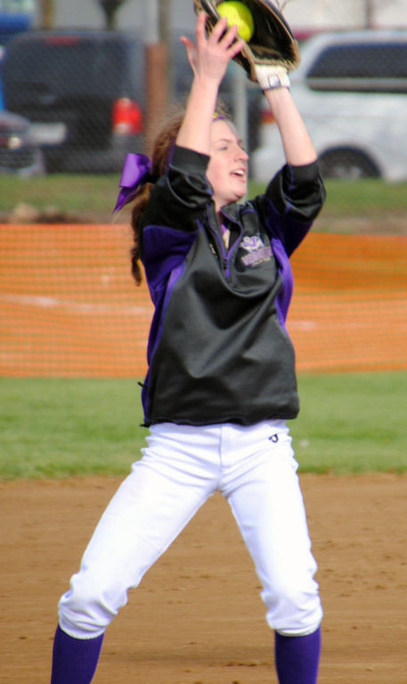 . Jon Behm - The Morning Journal<br> Vermilion\'s Maria Keller secures a pop fly against Northwestern at Wellington Community Park during the Prebis Memorial Classic on April 27.