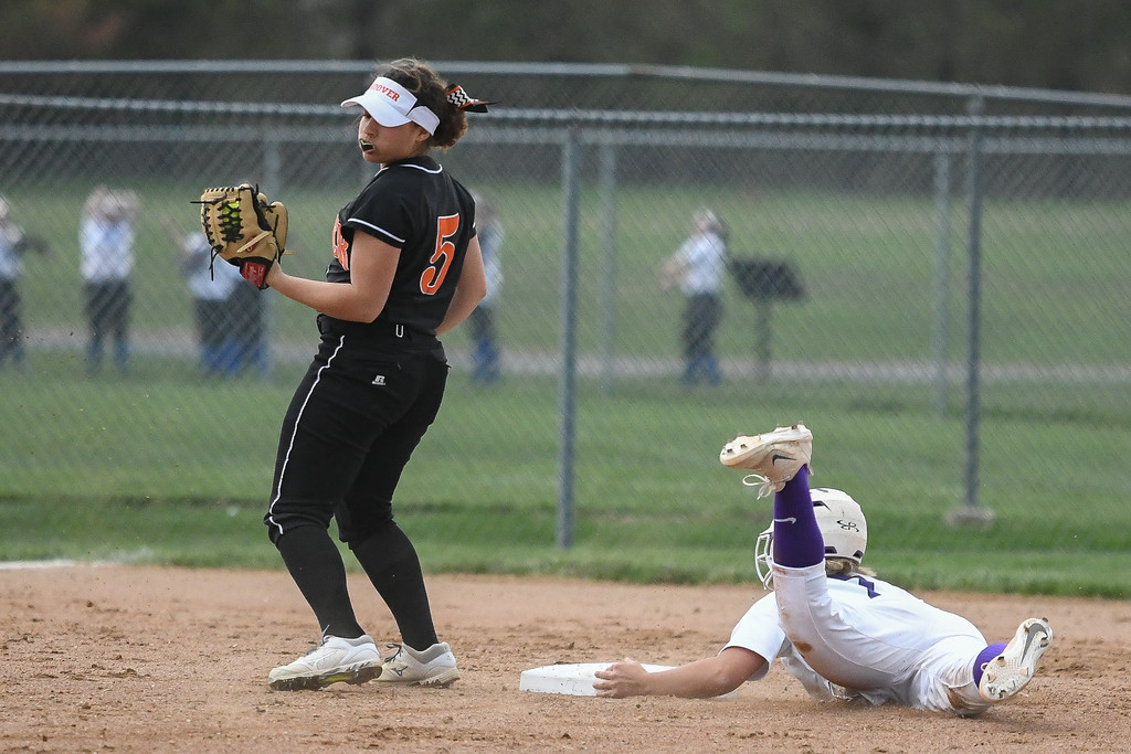 . Eric Bonzar�The Morning Journal<br> Keystone\'s Autumn Acord keeps a hand on the bag as she steals second base against North Canton Hoover a LaGrange Community Park during the Prebis Memorial Classic on April 27.