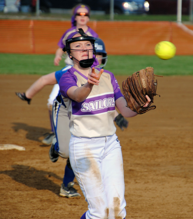 . Jon Behm - The Morning Journal<br> Vermilion\'s Erica Eschenauer flips to third for the force out against Northwestern at Wellington Community Park during the Prebis Memorial Classic on April 27.