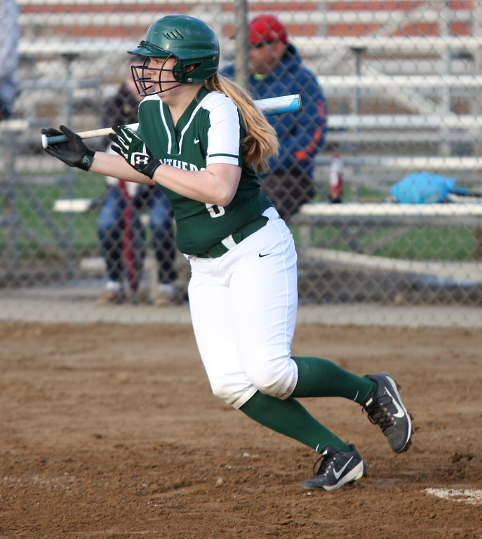 . Randy Meyers - The Morning Journal<br> Meghan Allegretto of Elyria Catholic lines a base hit against Fairview during the Prebis Memorial Classic at Wellington Community Park on April 27.