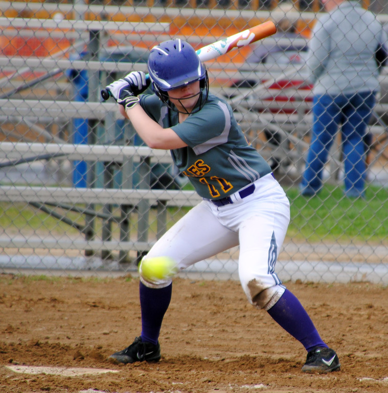 . Jon Behm - The Morning Journal<br> Avon\'s Julia Stoiffere passes on a pitch a the knees against North Royalton at Wellington Community Park during the Prebis Memorial Classic on April 27.