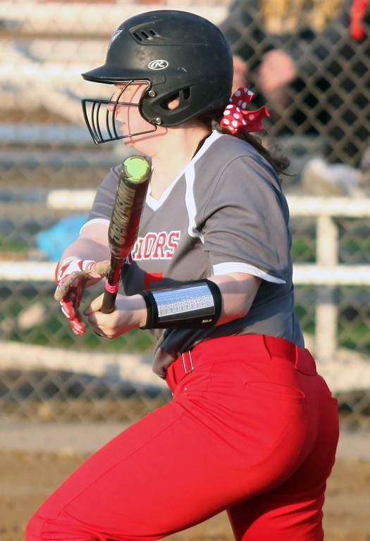 . Randy Meyers - The Morning Journal<br> Lizzy Williams of Fairview lines a hit against Elyria Catholic during the Prebis Memorial Classic at Wellington Community Park on April 27.