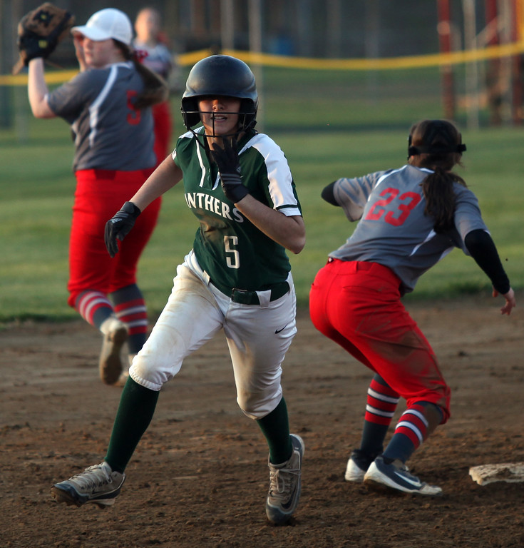 . Randy Meyers - The Morning Journal<br> Stephanie Griffin of Elyria Catholic runs past second base against Fairview during the Prebis Memorial Classic at Wellington Community Park on April 27.