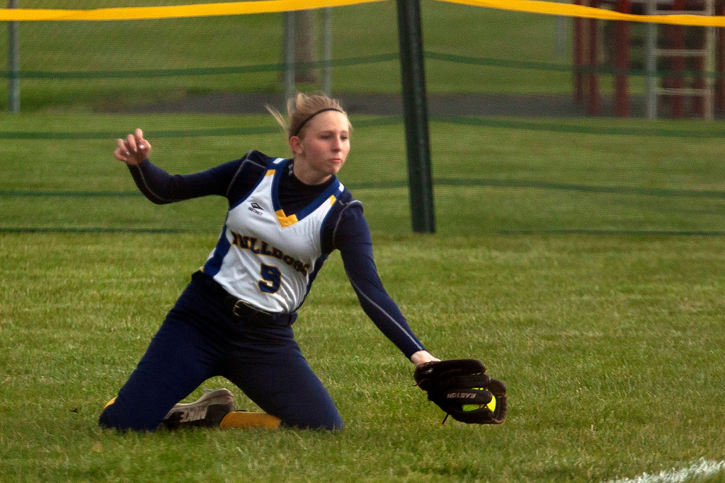 . Jen Forbus - The Morning Journal<br> Olmsted Falls right fielder Kelly Grospitch reaches to catch a fly ball and secure an out in the Bulldogs\' game with the Wellington Dukes on April 27 during the Prebis Softball Classic at Wellington Community Park.