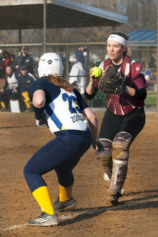 . Jen Forbus - The Morning Journal<br> Wellington catcher Makaylin Moore catches Olmsted Falls\' Ashely Zgodzinski when she tries to scores on April 27.