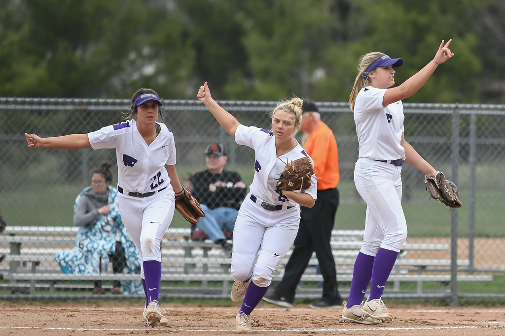 . Eric Bonzar�The Morning Journal<br> Keystone pitcher Syndey Campbell, right, signals two outs after striking out her second North Canton Hoover batter of the inning at LaGrange Community Park during the Prebis Memorial Classic on April 27.