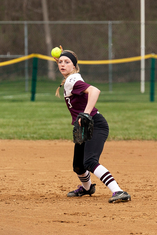 . Jen Forbus - The Morning Journal<br> Wellington shortstop Allissa Boraggina takes aim to make a throw to first base during the Dukes\' game with Olmsted Falls on April 27 during the Prebis Softball Classic at Wellington Community Park.