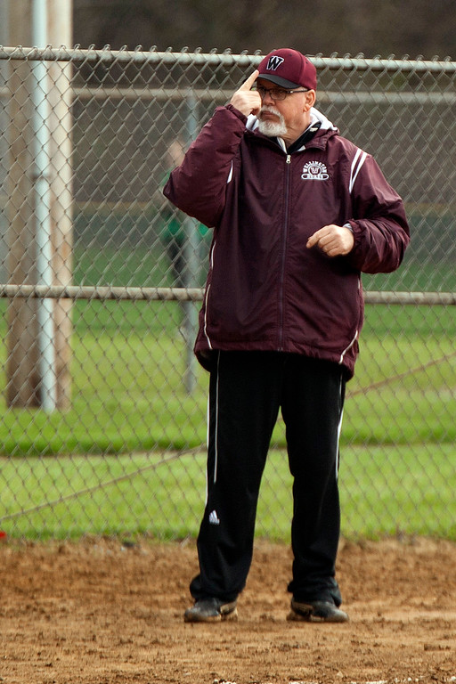 . Jen Forbus - The Morning Journal<br> Wellington coach Duane Sunagel gives his team signs from third base.