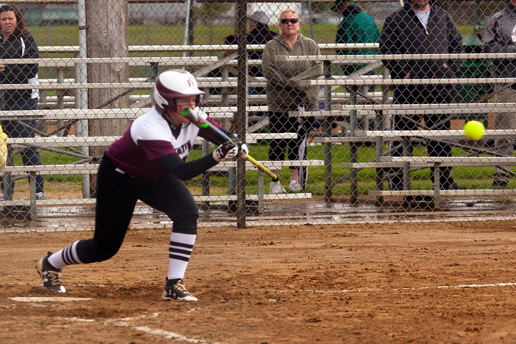 . Jen Forbus - The Morning Journal<br> Wellington\'s Rianna Rosencrans lays down a bunt against Olmsted Falls on April 27 during the Prebis Softball Classic at Wellington Community Park.