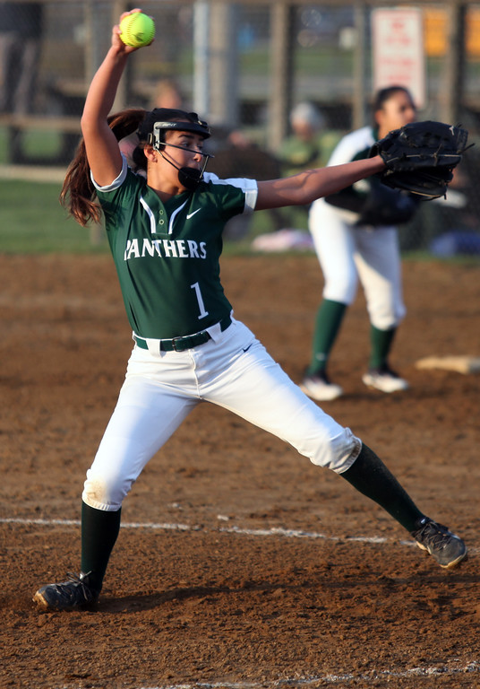 . Randy Meyers - The Morning Journal<br> Elyria Catholic\'s Ashley Cascio delivers a pitch against Fairview during the Prebis Memorial Classic at Wellington Community Park on April 27.
