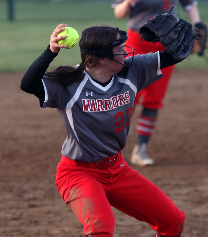 . Randy Meyers - The Morning Journal<br> Lauren Leslie of Fairview fields a ground ball and throws to first for the out against Elyria Catholic during the Prebis Memorial Classic at Wellington Community Park on April 27.
