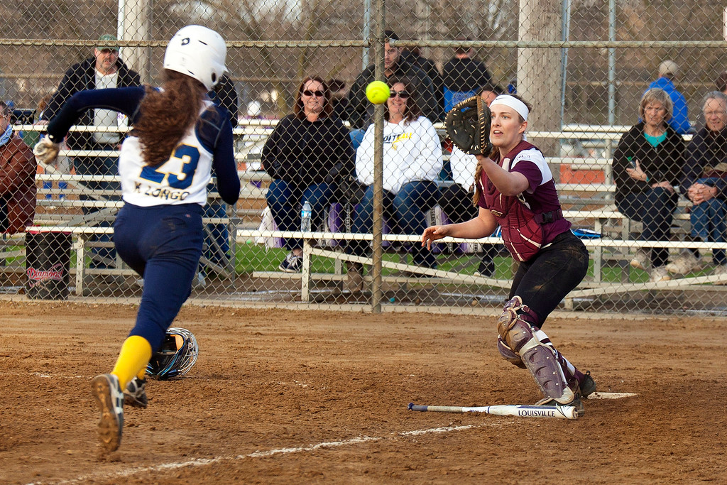 . Jen Forbus - The Morning Journal<br> Olmsted Falls\' Kyra Longo tries to beat the throw home in the Bulldogs contest against with the Wellington Dukes on April 27 during the Prebis Softball Classic at Wellington Community Park.