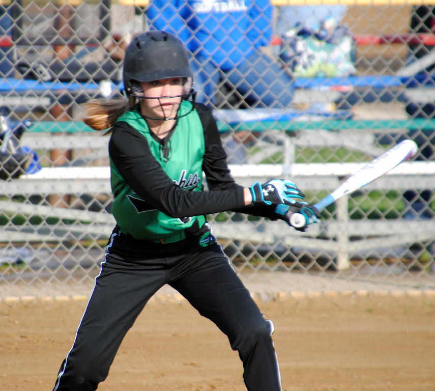 . Jon Behm - The Morning Journal<br> Columbia\'s Avery Lavinder watches her hit against Brunswick at Wellington Community Park during the Prebis Memorial Classic on April 27.
