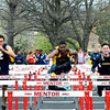 Brittany Chay - The News-Herald<br /> Brush's Jai Dixon participates in the hurdles during the Mentor Cardinal Relays on April 30.