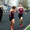 Brittany Chay - The News-Herald<br /> University's JP Trojan takes a handoff from Reid Banbury during the Mentor Cardinal Relays on April 30.