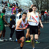 Brittany Chay - The News-Herald<br /> Robbie Seaton hands off to Joe Brickman during the Mentor Cardinal Relays on April 30.