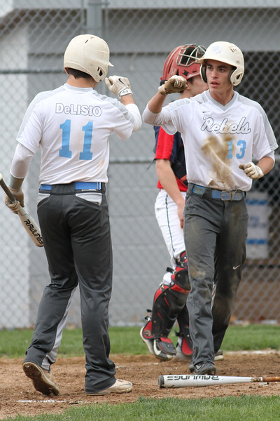Michael Johnson - The News-Herald<br /> Willoughby South's Mark Delisio (left) and Chet Waddell (right) celebrate after scoring a run during the South vs Kenston baseball game at Willoughby South High School on May 4, 2016. South defeated Kenston 7-3.