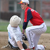 Michael Johnson - The News-Herald<br /> Kenston's Patrick Persichetti tags out Willoughby South's Justin Veasey at 2nd base during the South vs Kenston baseball game at Willoughby South High School on May 4, 2016. South defeated Kenston 7-3.
