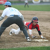 Michael Johnson - The News-Herald<br />  Kenston's Stephen Szczesniak (right) slides into 1st base to beat Anthony Cesar's tag (left) during the South vs Kenston baseball game at Willoughby South High School on May 4, 2016.  South defeated Kenston 7-3.