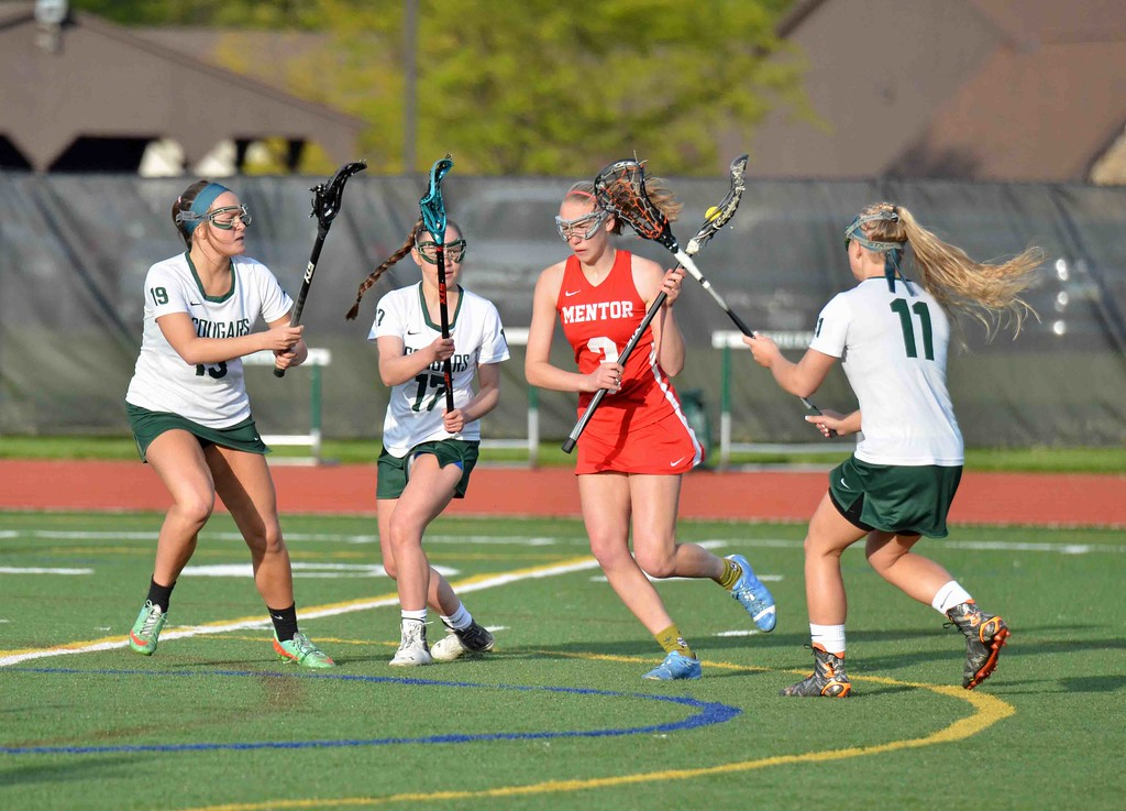 . Paul DiCicco - The News-Herald Mentor\'s Lillian Miller navigates the Lake Catholic defense.
