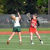 Paul DiCicco - The News-Herald<br />  Face off to open play.  Mentor at Lake Catholic on May 10.