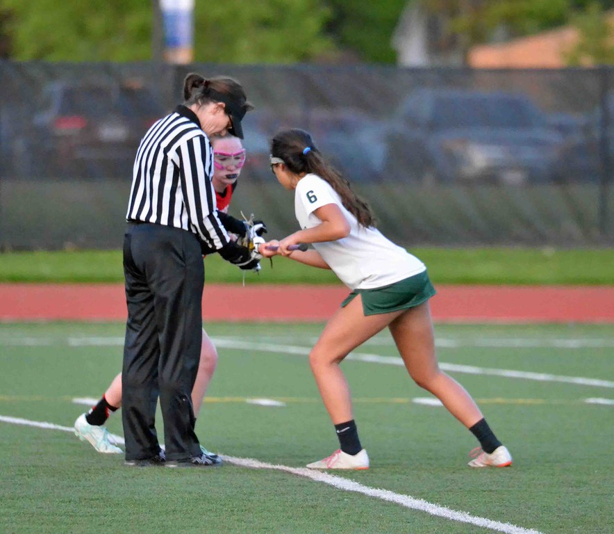 . Paul DiCicco - The News-Herald Lake Catholic\'s Kati Druzina and Mentor\'s Alyson McMahon face off late in the game.