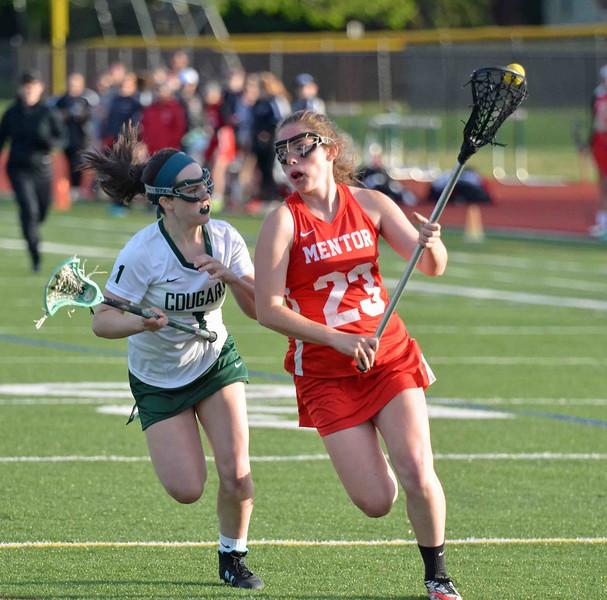 Paul DiCicco - The News-Herald<br />  Lake Catholic's Lily Rogers runs step-for-step with Mentor's Ashlynn Benedict as Ashylnn heads toward the goal.