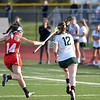 Paul DiCicco - The News-Herald<br />  Lake Catholic's Emily Osborne takes off toward the sideline, but is hounded by Mentor's Katelym Stuart the whole way.